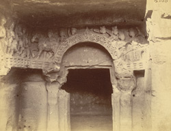 Close view of doorway and frieze on right-hand side of lower storey of the Rani Gumpha, Udayagiri